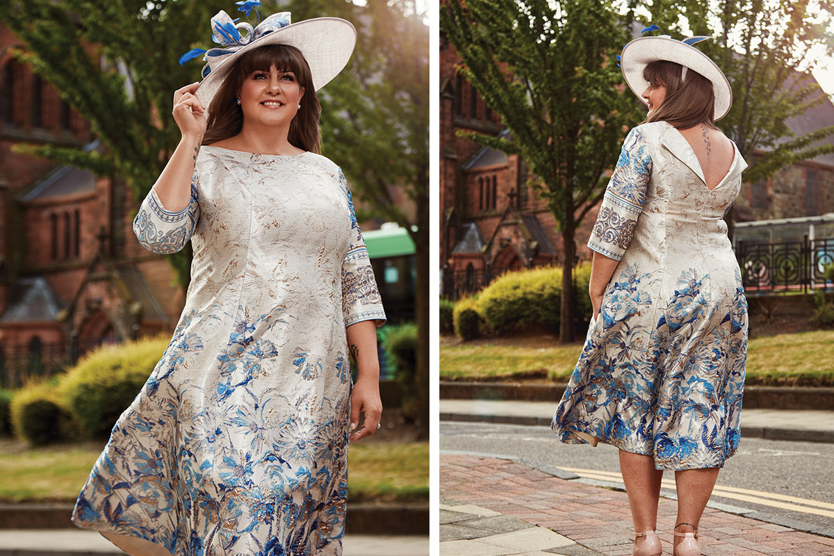 A lady wearing a floral dress and matching hat from Frox of Falkirk