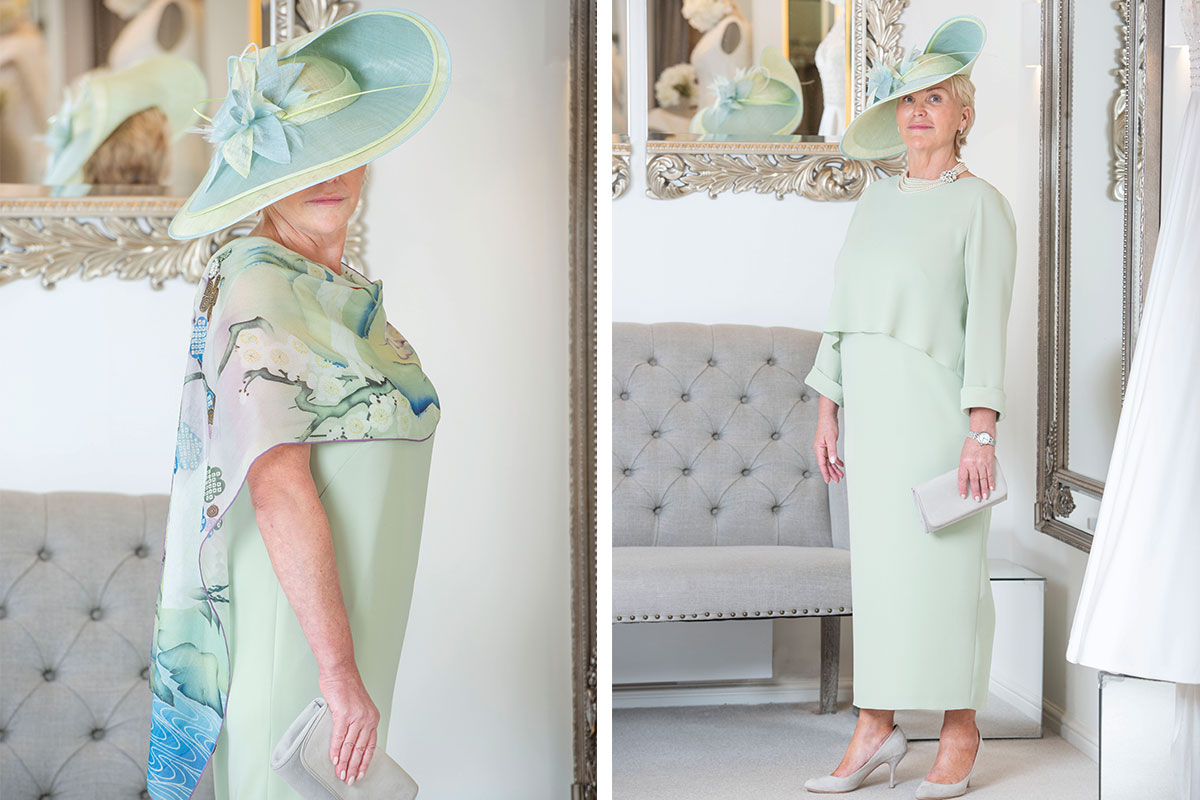 A lady wearing a mint green dress and hat from Joyce Young Design Studios