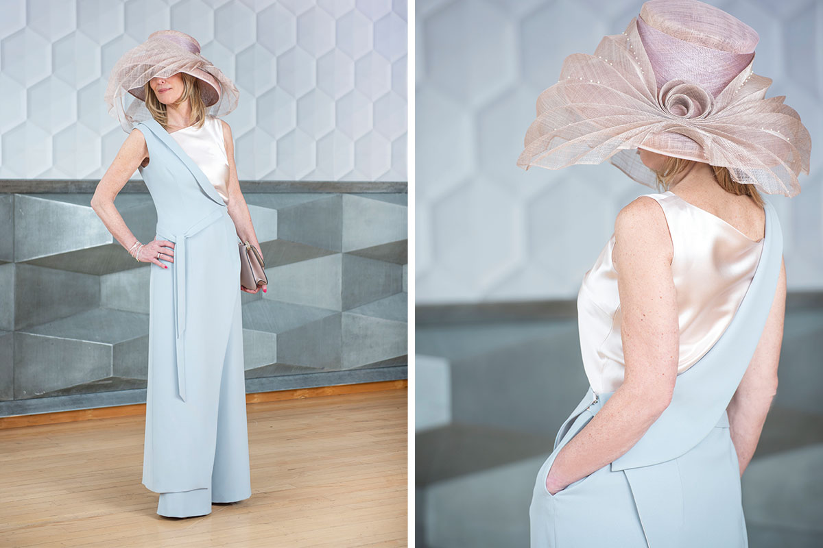 A lady wearing a pale blue trouser outfit with satin camisole designed and made by Rinaldo Girasoli