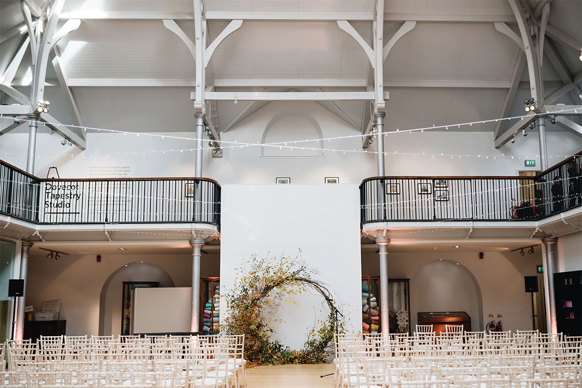 The weaving floor at Dovecot Studios in Edinburgh set for a wedding with circular floral moongate
