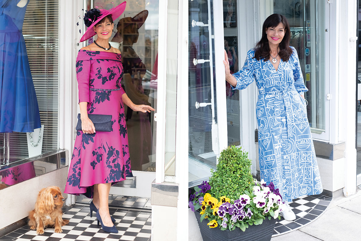 Karen Charles of Patricia Forbes Ladies Fashions wearing two outfits at the front door of her shop