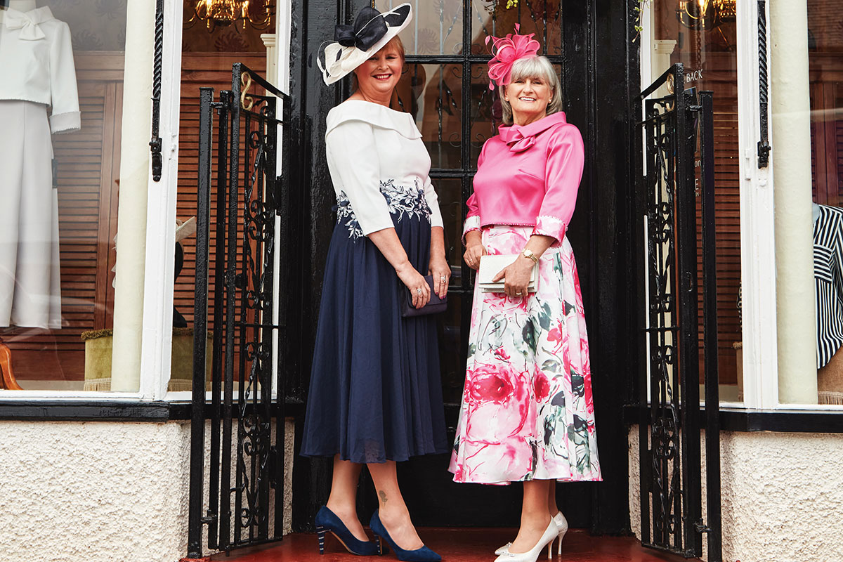 two ladies wearing Veni Infantino dresses from Sheila Conn Ladies Fashions in Biggar