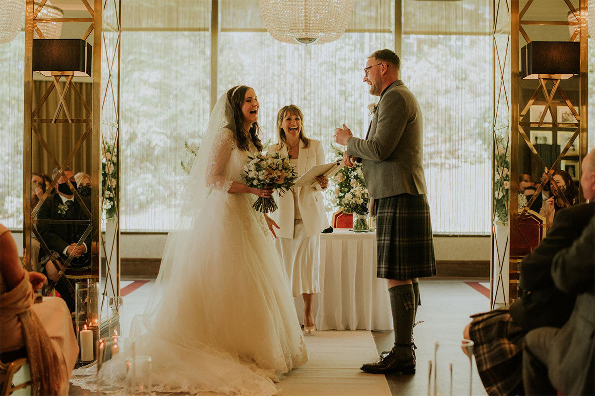 A couple exchanges vows in front of their guests and a celebrant