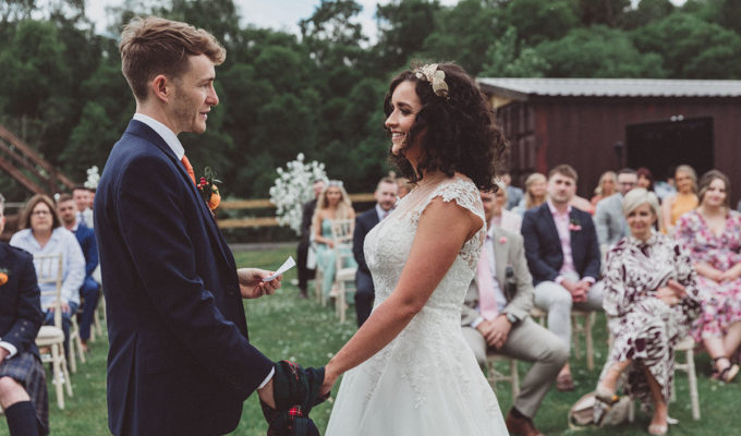 bride and groom holding hands during outdoor wedding ceremony at Eden Leisure Village
