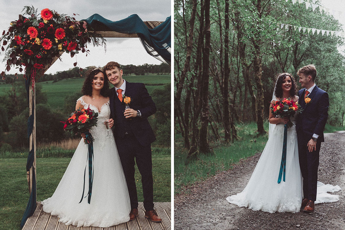 bride and groom pose under autumn flowers ceremony arch and bunting at Eden Leisure Village