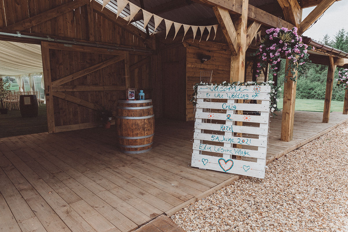 exterior of Eden Leisure Village decorated for a wedding with a pallet order of day and bunting