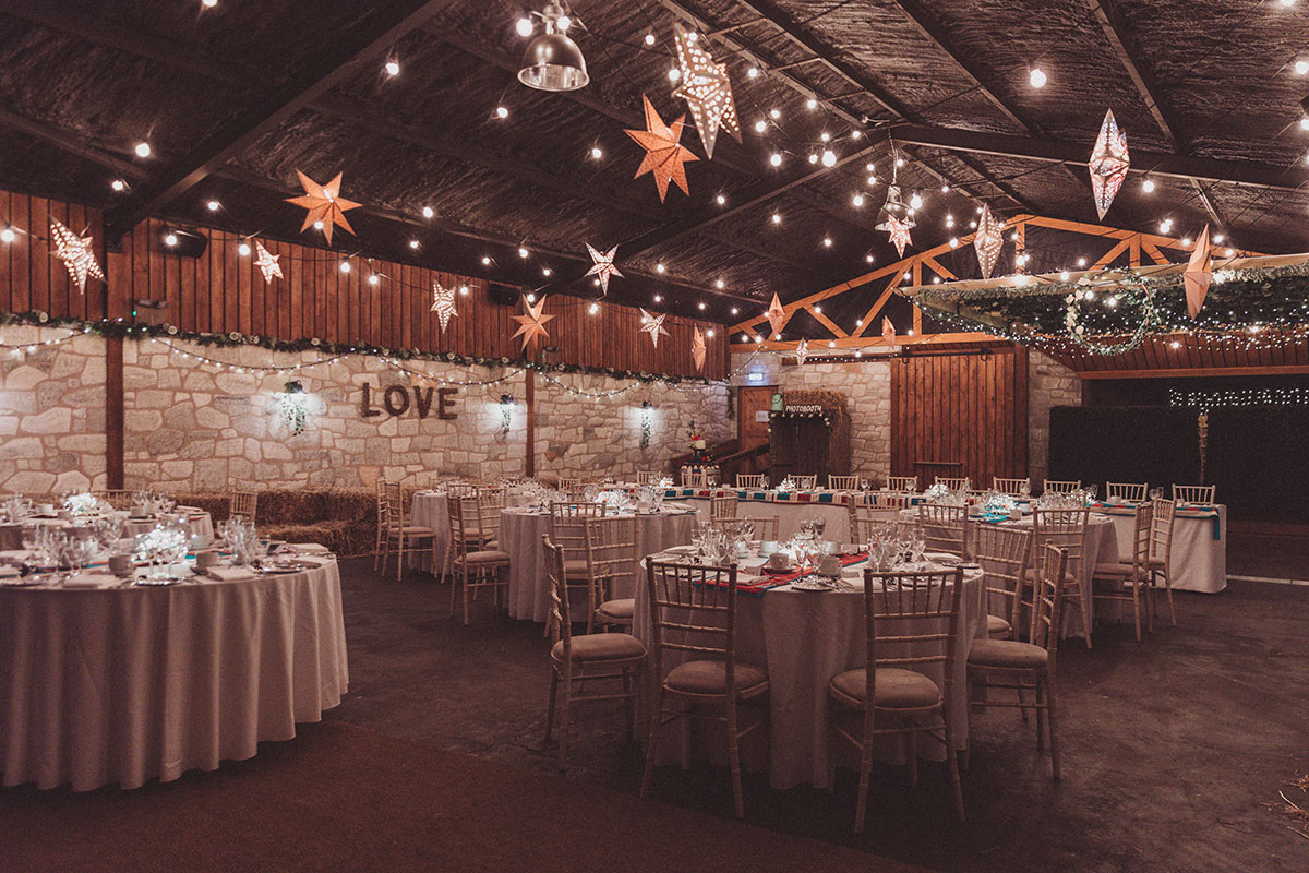 inside Eden Leisure Village with tables laid out and decorated for a wedding