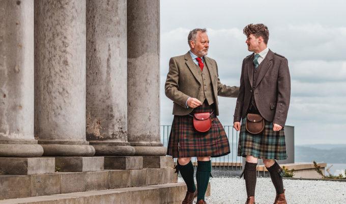 Two men wearing kilts by Gordon Nicolson Kiltmakers walking along Calton Hill in Edinburgh