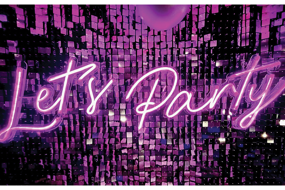 Shimmer wall and Let's Party neon sign by LA Create