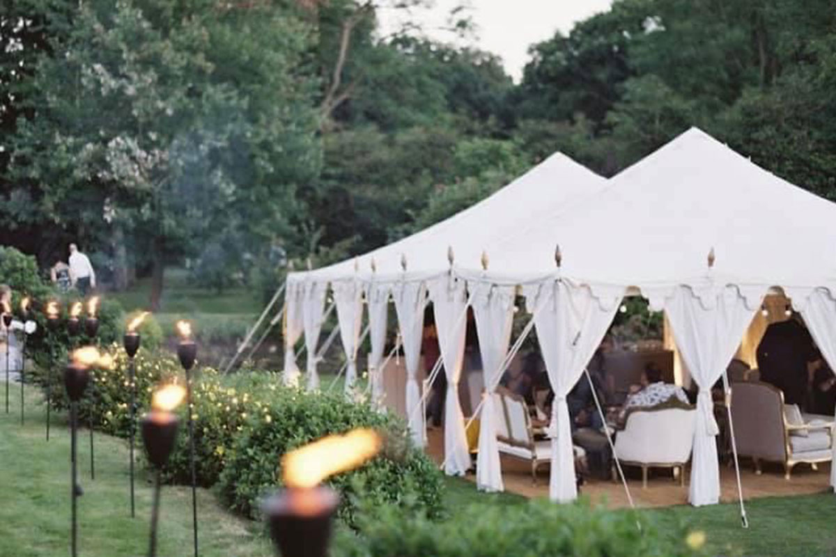A wedding tent set up from Backdrops & Buttercream