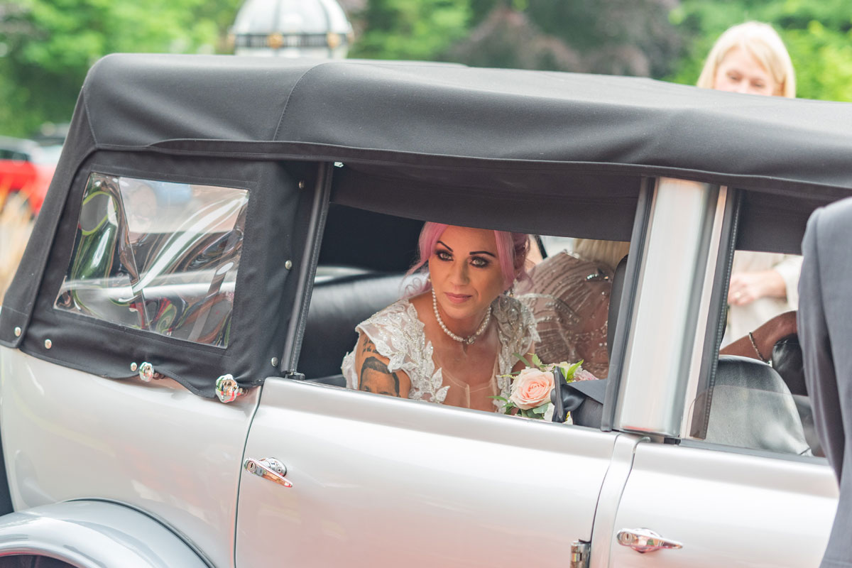 bride arriving in Premier Carriage vintage car