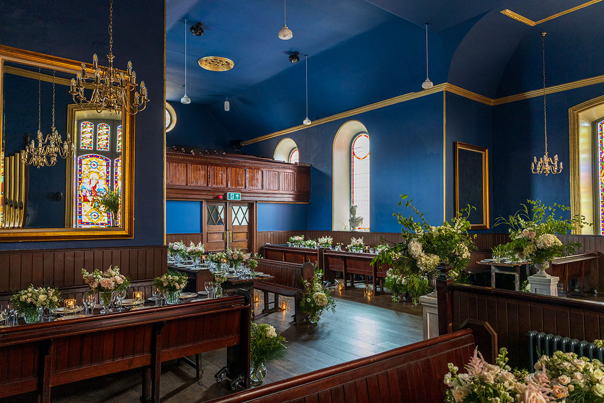 the interior of the Harbour Chapel in Dunbar dressed in flowers and candlellight