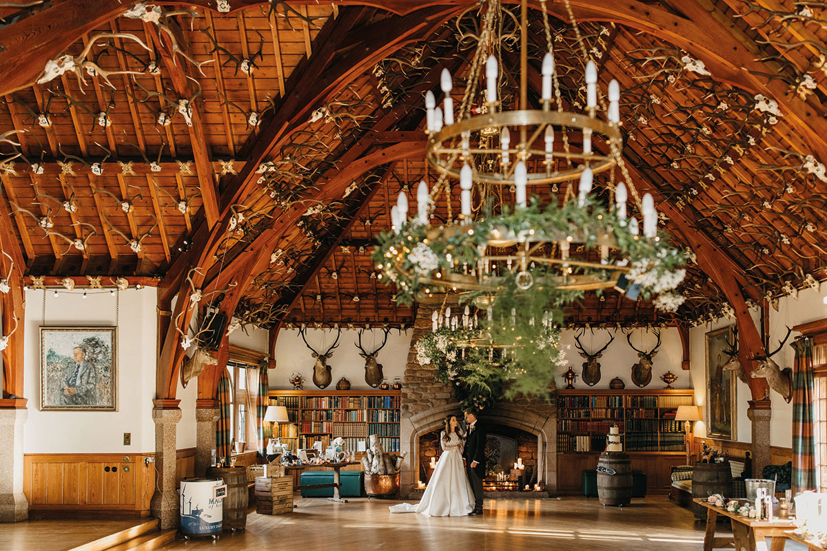 A bride and groom in the ballroom at Glen Tanar Estate