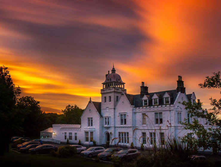 The exterior of Skeabost House Hotel, one of Sonas Collection's properties on the Isle of Skye