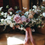 Summer bouquet with peonies, rosesm sweet peas, stocks and nigella fro Studio Seapink, sitting on an armchair
